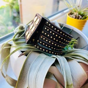 Leather cuff with gold studded clasp detail